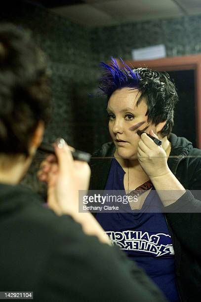 Biertrix of the Rainy City Rollar Girls applies makeup before the Rollergirls Roller Derby event on April 14 2012 in Oldham England The contact sport...