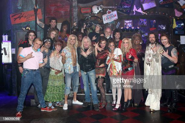 Biff Byford of Saxon meets cast members including Justin Lee Collins 2 from R backstage at 'Rock Of Ages' The Musical at the Shaftesbury Theatre on...