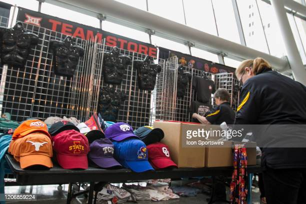 Big 12 vendors break down signage and clothing due to the cancellation of the Big 12 Tournament to prevent the spread of the Coronavirus prior to the...