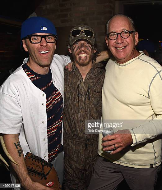 Big 98's Bobby Bones Singer/Songwriter Chris Janson and John Esposito President/CEO Warner Music Nashville backstage at The Big 98's 3rd Annual...