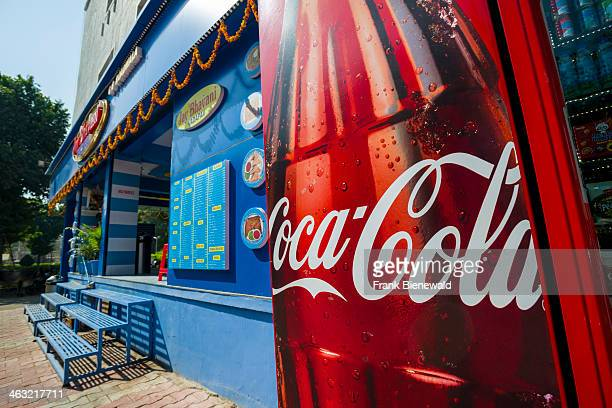 A big advertisement for Coca Cola at the entrance of a new western style restaurant