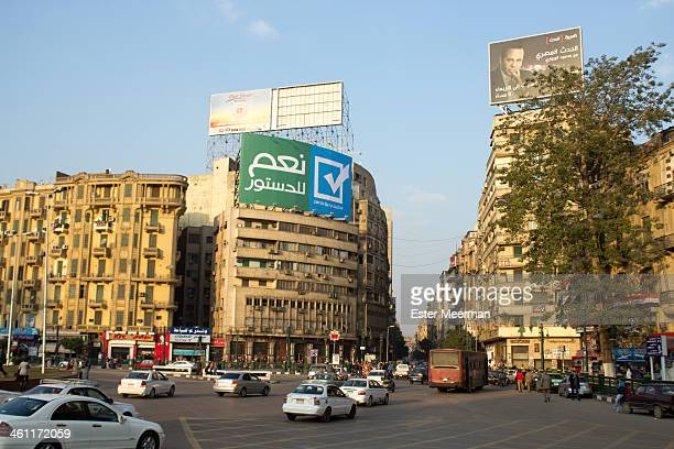 CONTENT] A big advertisement on Tahrir square in Cairo Egypt urging people to vote 'yes to the constitution' On 3 July 2013 after the ouster of...