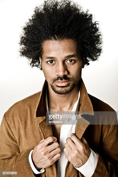 Big afro man staring into the camera with serious look