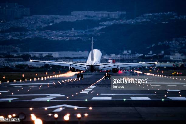 A big airplane arrives at the airport.