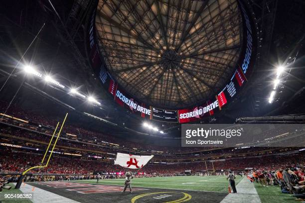 Big Al the mascot for the Alabama Crimson Tide waves a flag in the endzone during the second half against the Georgia Bulldogs in the CFP National...