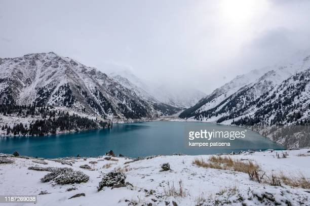 big almaty lake is a highland reservoir and natural landmark in almaty, kazakhstan. - kazakhstan stock pictures, royalty-free photos & images