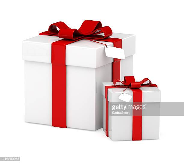Big and small white square gift boxes with red bows