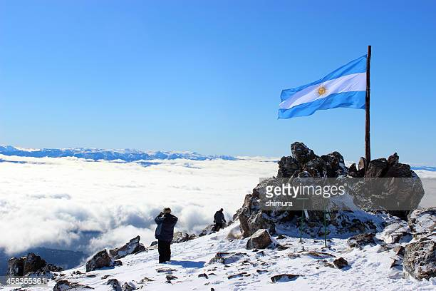 Big Argentina Flag and Tourists at Andes mountains - Patagonia