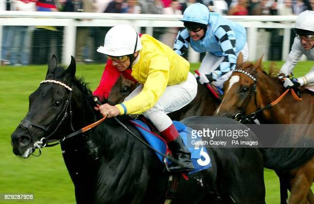 Big Bad Bob ridden by Frankie Dettori wins the Gilbey Brother's Silver Mircophone Conditions Guaranteed Sweepstakes at Doncaster