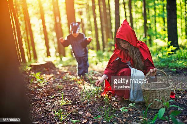 Big Bad Wold sneaking on Little Red Riding Hood