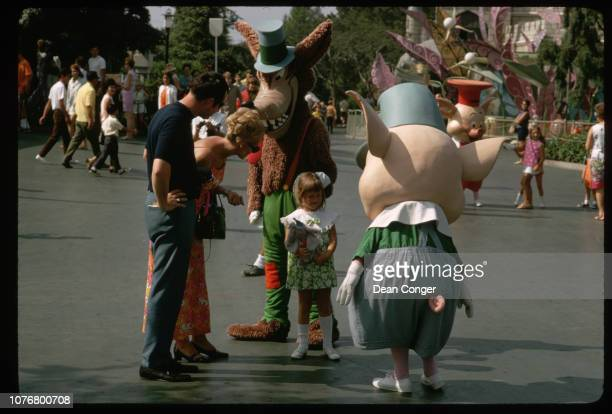 Big Bad Wolf and Little Pig Scaring Girl at Disneyland