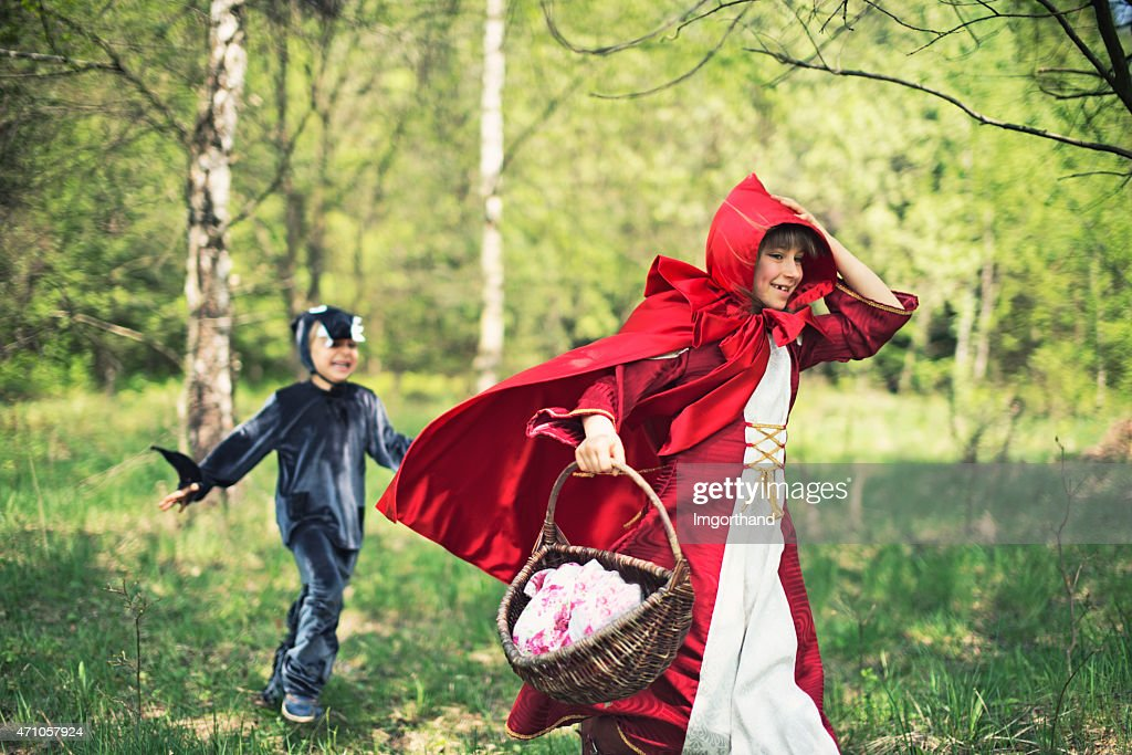 Big Bad Wolf chasing the Little Red Riding Hood : Stock Photo
