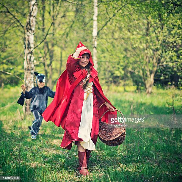 Big Bad Wolf chasing the Little Red Riding Hood