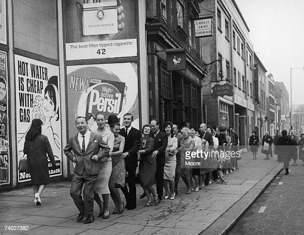 Big Bandleader Joe Loss introduces the Finnjenka a Finnish version of the Conga outside the Hammersmith Palais 22nd October 1964 He is publicising...