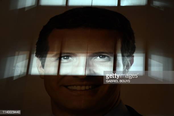 Big banner depicting Spanish conservative People's Party leader and candidate for prime minister Pablo Casado hangs on the party's headquarters...