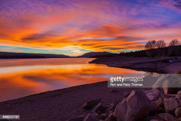 big bear lake romantic sunset with reflections and cloudscape, ca - big bear lake stock pictures, royalty-free photos & images