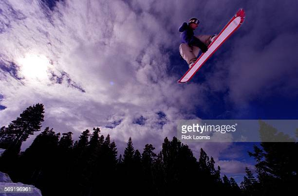 Big Bear––A snowboarder launches into the air on one of the bigger hits at Snow Summits new Ego Trip Super Park during a recent Sunday morning Snow...