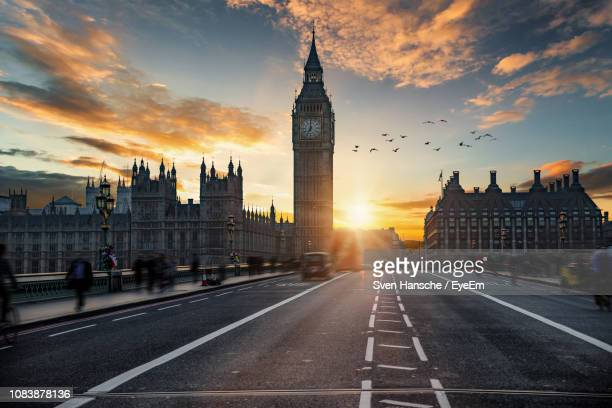 big ben against sky during sunset - london england stock-fotos und bilder