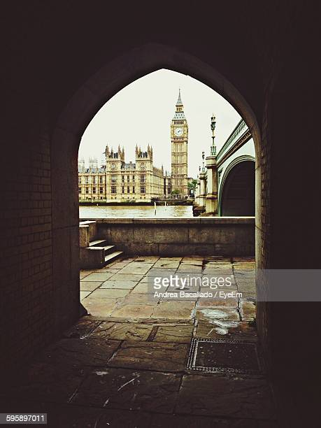 big ben and houses of parliament against clear sky seen through archway - westminster bridge stock pictures, royalty-free photos & images