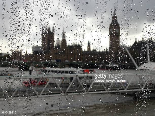 Big Ben And Houses Of Parliament Seen Through Wet Glass During Rainy Season