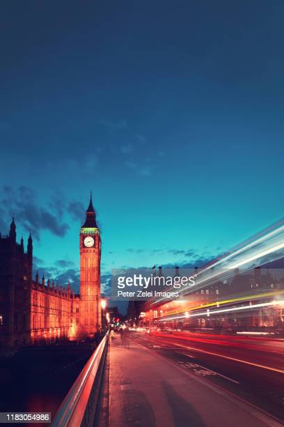 big ben and the house of parliament in london at dusk - central london stock pictures, royalty-free photos & images