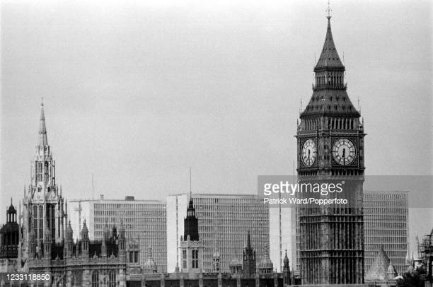 Big Ben and the Houses of Parliament with office blocks beyond in central London, circa June 1969. From a series of images to illustrate the many...