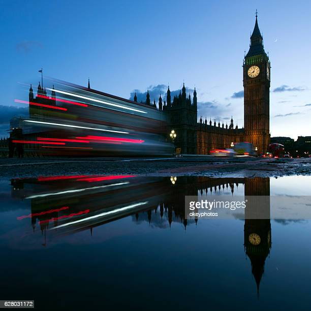 big ben at dusk with traffic lights, london - monument station london stock photos and pictures