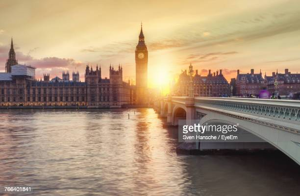 big ben by thames river during sunset - thames river stock pictures, royalty-free photos & images