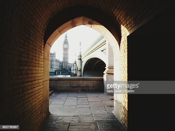 big ben seen through archway - westminster bridge stock pictures, royalty-free photos & images