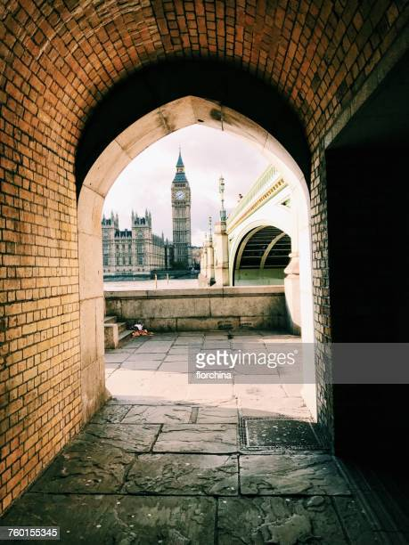 big ben viewed through an arch, london, england, uk - city of westminster london stock photos and pictures
