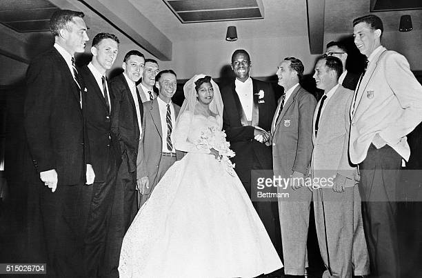 Big Bill Russell one of the stars of the US Basketball team that won the gold medal in the Olympics at Melbourne is shown with his bride the former...