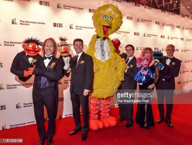 Big Bird and his cohorts along with their human operators arrive on the red carpet for the 42nd annual Kennedy Center Honors including Earth Wind...