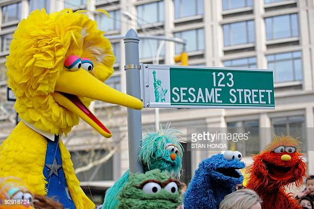 Big Bird and other Sesame Street puppet charactors pose next to temporarty street sign November 9 2009 at West 64th Street and Broadway in New York...
