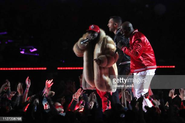 Big Boi Adam Levine of Maroon 5 and Sleepy Brown perform during the Pepsi Super Bowl LIII Halftime Show at MercedesBenz Stadium on February 03 2019...