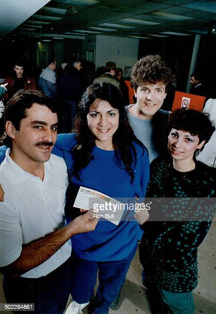 Big bonanza: While $100;000 winners Charles and Susan LaBonte; with Susan's brother and sister-in-law John and Monique Skoczen; enjoy the spotlight;...