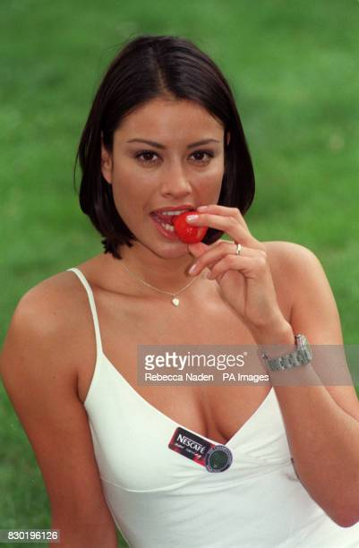 Big Breakfast presenter Melanie Sykes tastes a strawberry at Leicester Square Gardens London to announce that Nescafe will be the official coffee of...