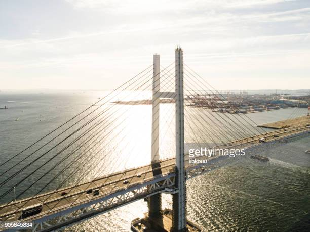 A big bridge and the sea.