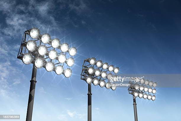 Big bright stadium lights on a summer night