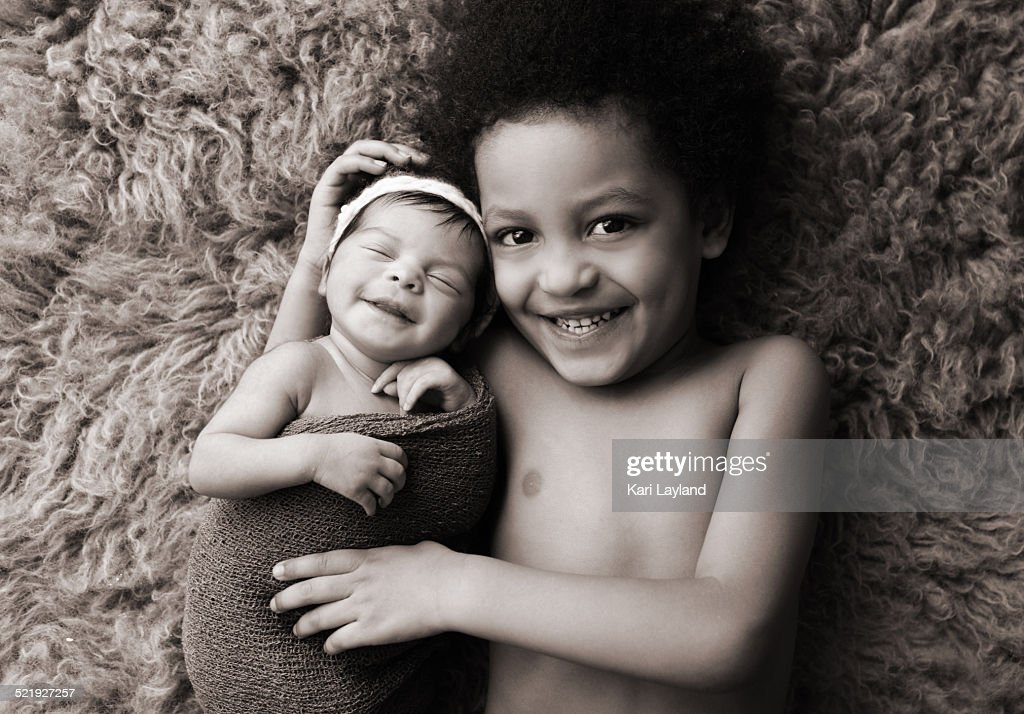Big brother baby sister smiles : Stock Photo