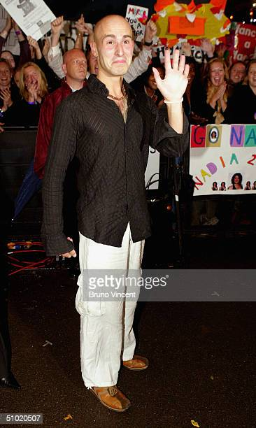 Big Brother housemate Marco Sabba poses for photographs outside the Big Brother house at Elstree Studios on July 2 2004 in Hertfordshire England...