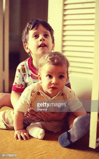 big brother playing with his baby sister - archival stock pictures, royalty-free photos & images