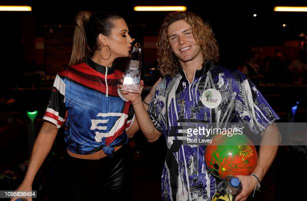 'Big Brother' stars Angela Rummans kisses the trophy that Tyler Crispin won during the 2019 State Farm Chris Paul PBA Celebrity Invitational on...