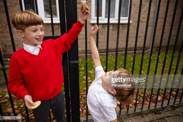big brother teasing little brother - teasing stock pictures, royalty-free photos & images