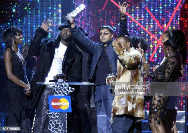 Big Brovaz and Punjabi MC on stage with their joint award for UK Act of the Year during the Mastercard MOBO Awards 2003 at the Royal Albert Hall in...