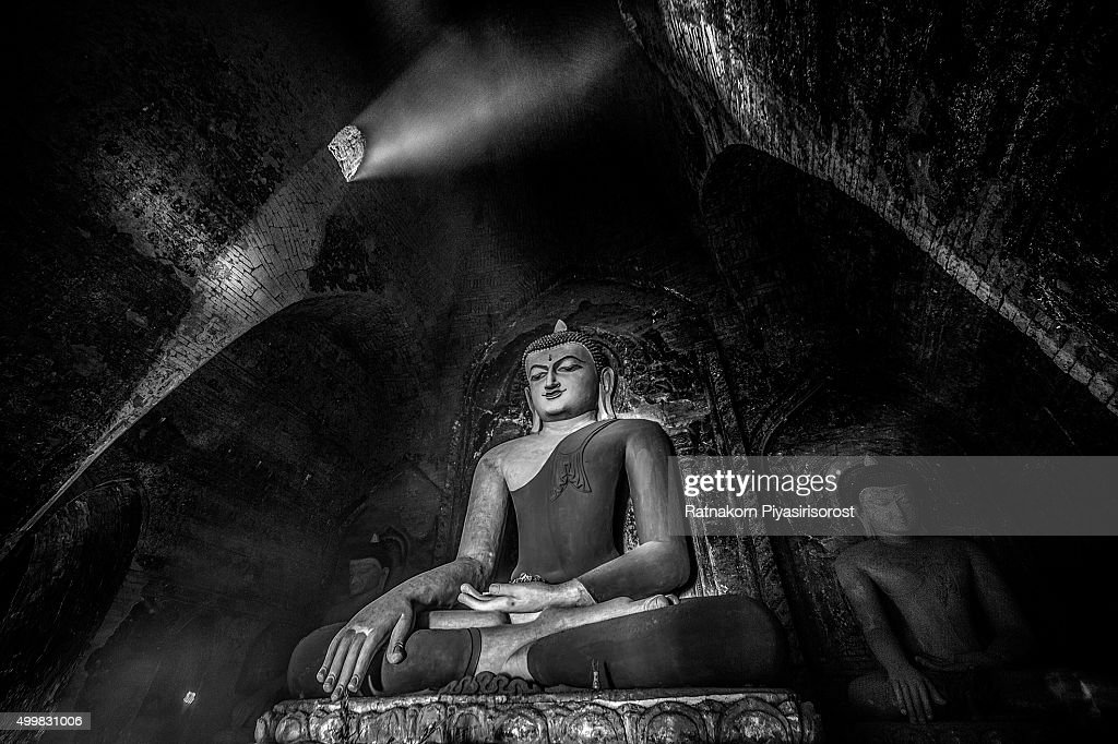 Big Buddha Statue And Mini Monk In Meditation Inside Temple Bagan Mandalay Myanmar Stock
