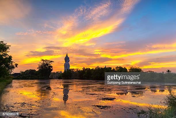 Big Buddha statue on sunrise sky