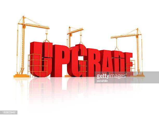 big bulky red letters on an orange crane saying upgrade - building icon stock photos and pictures