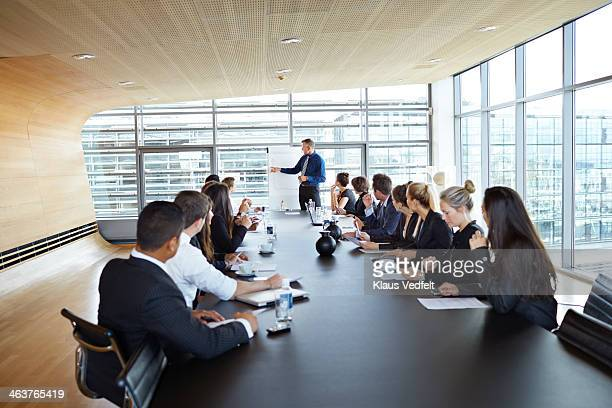 big business presentation with flip board - board room stock pictures, royalty-free photos & images