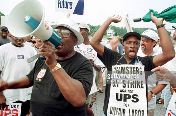 Big C. Mason and Jeff Smith rally the the estimated 5,000 picketers and Teamsters supporters at a unity rally near the Norcross, GA, UPS hub 14...
