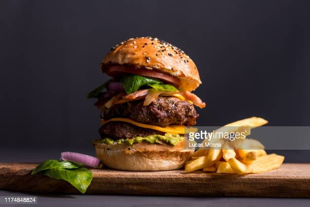 big cheese burger with fries - burger stock pictures, royalty-free photos & images